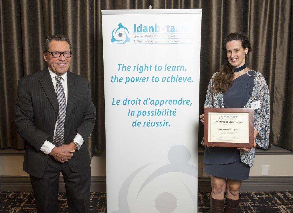 LDANB Board President, Roger Duval, presents framed certificate to Julie Smith (Elementary Literacy Inc.)